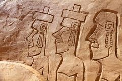 Sand sculpture Easter island. Sand sculpture: Easter island stylized men faces bas-relief Royalty Free Stock Images