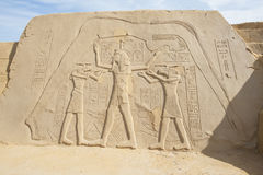 Sand sculpture of egyptian hieroglyphics carvings Stock Images