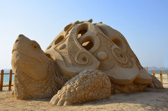 Sand sculpture - giant turtle. Royalty Free Stock Images
