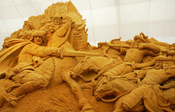 Sand sculpture of knightly battle Stock Photo