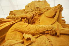 Sand sculpture of knightly battle Royalty Free Stock Photos