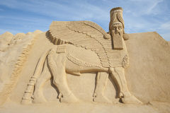 Sand sculpture of Lamassu deity Stock Photo