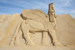 Sand sculpture of Lamassu deity Stock Photo