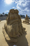 Sand sculpture lovers on the beach Royalty Free Stock Images