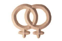 Sand sculpture of male gay sign. Two male signs figuring homosexuality sculptured in sand Royalty Free Stock Photos