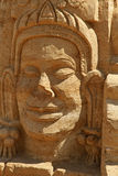 Sand sculpture man face. Sand sculpture: ethnic man face bas-relief Royalty Free Stock Photo