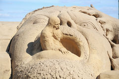 Sand sculpture: old man (wizard) and huge head Stock Image