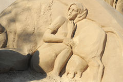 Sand sculpture: scared cow girl Royalty Free Stock Image