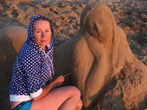 Sand sculpture and the sculptor Stock Photography