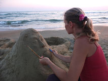 Sand sculpture and the sculptor Royalty Free Stock Photos