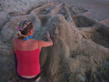 Sand sculpture and the sculptor Stock Photo