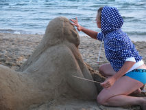 Sand sculpture and the sculptor Stock Images
