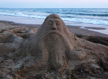Sand sculpture and the sea Royalty Free Stock Photos