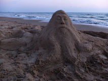 Sand sculpture and the sea Royalty Free Stock Photography