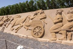sand sculptures of ancient romans gladiators on a chariot