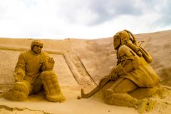 Sand sculptures of hockey players from the past and modern in the town Imatra Finlandand stock image