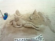 Sand sculptures - Two men with animals Stock Photography