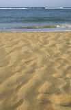 Sand and Sea. Perfect sand leading to the sea royalty free stock photography