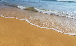 Sand, sea, shore Stock Image