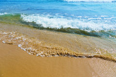 Sand, sea, shore Stock Images