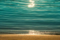 Sand, sea and sun glare. Beautiful picture on a quiet beach in the evening Royalty Free Stock Photos