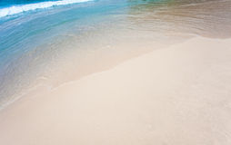 Sand and sea wave Stock Image