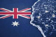 Sand and sea  wave background or texture with blending  Australia flag Royalty Free Stock Photos