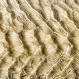 Sand see through water Royalty Free Stock Photos