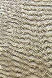 Sand see through water background Royalty Free Stock Photo