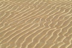 Sand shapes in a beach Stock Images