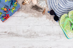 Sand and shells and hat on the wooden floor, summer concept Royalty Free Stock Photography