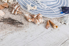 Sand and shells and hat on the wooden floor, summer concept Stock Photo