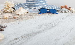 Sand and shells and hat on the wooden floor, summer concept Stock Photography