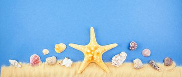 Sand shells and starfish on a blue background. Coast Copy space for text Banner concept Flat lay royalty free stock photos