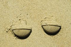 Sand ships. Sand forms of toy ship royalty free stock photo