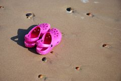 Sand shoes. Pink sand shoes on the beach Royalty Free Stock Photos