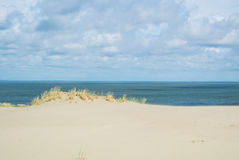 The sand shore and the sea. The sand shore and the sea under the clouds at Lithuania, Curonian Spit, Nida dune Stock Photo