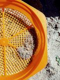 Sand sifter. Orange sand sifter bright and crisp Royalty Free Stock Image