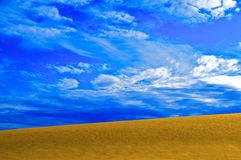 Sand and sky. Desert, golden sand and sky Stock Photography