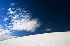 Sand and Sky. Clouds over a dune in the White Sands National Monument, New Mexico, USA stock image
