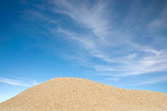 Sand and sky. Pile of sands and blue sky stock images