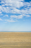 Sand and sky in the beach Stock Photos