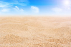 Sand and sky with clouds and sun Royalty Free Stock Photos