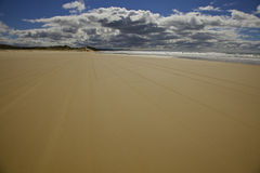 Sand and Sky on Fraser Island. Tire tracks on the beach. Fraser Island Queensland Australia Stock Photo