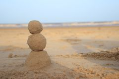Sand snowman for those who celebrate New Year by the sea royalty free stock photography