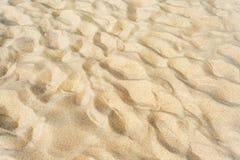 Sand som texturerad bakgrund Royaltyfria Bilder