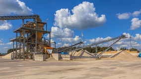 Sand sorting machine under blue clouded sky. Installation for sorting and washing sand for concrete production and construction activities stock photos