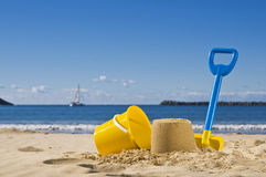 Sand,spade and bucket. Shot of the beach with a spade and bucket in foreground royalty free stock photos
