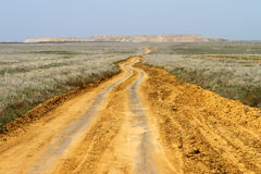 Sand spring steppe road. On blue sky background Stock Photo