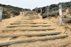 Sand stairs up a hill with wood polls Stock Photography